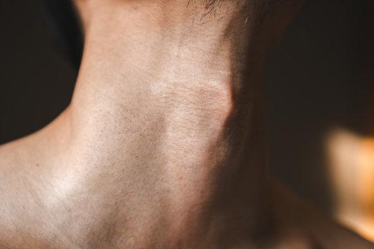 Man's neck with Adam's apple a part of body men humen anatomy close up shot.