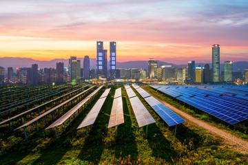 Photovoltaic and modern urban night scenes, Beijing, China.