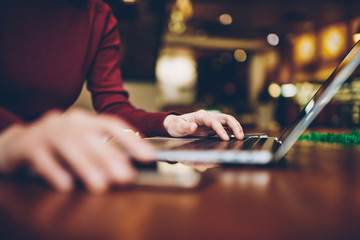 Selective focus on woman's hand keyboarding search query in browser while looking for information in network on laptop connected to internet.Cropped blurred image of female person using gadget