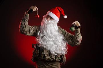 a man in a military uniform with a gun and a Santa Claus hat