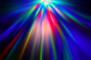 Multicolored rays of light shine through the facets of the crystal