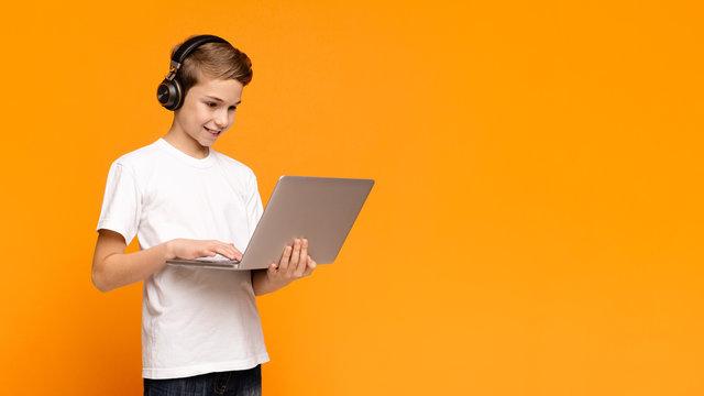 Teenage student watching webinar online on laptop