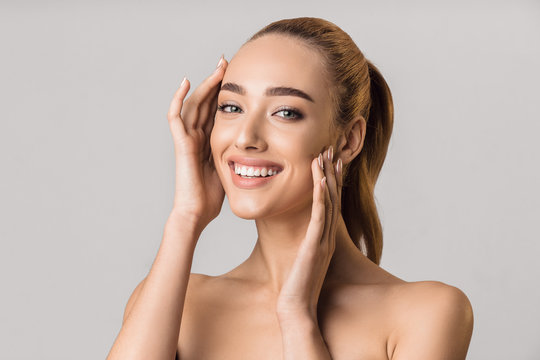 Skin care concept. Beauty woman touching her face