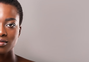 Fototapete - Half-face portrait of beautiful afro woman with perfect skin