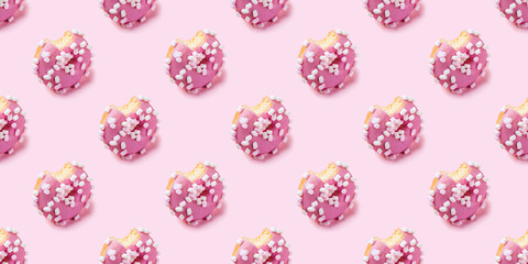 Fototapete - Seamless texture of Bitten pink icing donut with marshmallows on pink background, isometric view