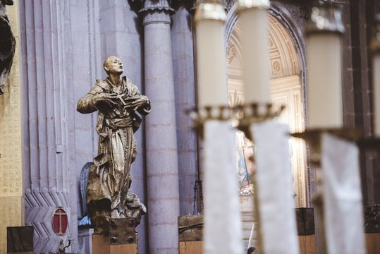 Selective focus shot of a religious statue in the church