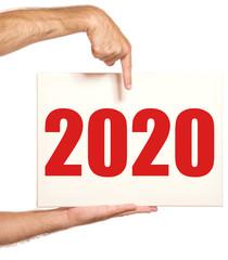 Hände halten Schild mit 2020