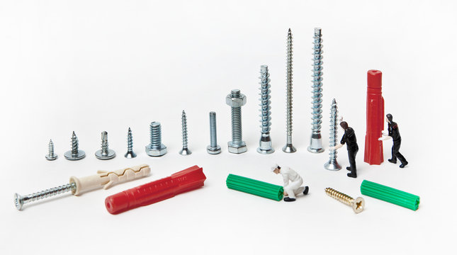 People dolls with mounting material and dowels of different calibers on a white background