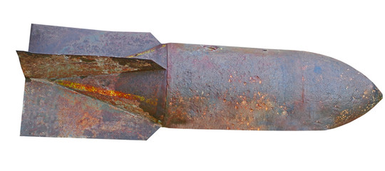 Old rusted World War II aerial bomb on white
