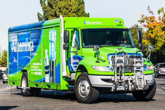 Oct 14, 2019 Mountain View / CA / USA - Close up of Alhambra water delivery service truck driving on a street