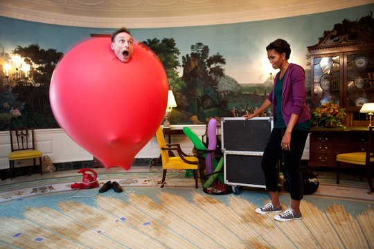 John Cassidy in a six-foot red balloon in the Diplomatic Reception Room with Michelle Obama