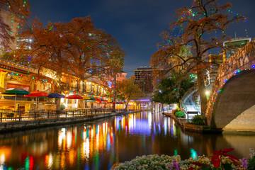 San Antonio River Walk and stone bridge over San Antonio River near Alamo in downtown San Antonio, Texas, USA.