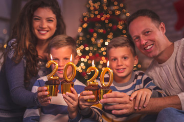 Parents celebrating New Year with kids