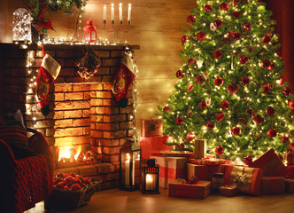 interior christmas. magic glowing tree, fireplace, gifts in  dark  .