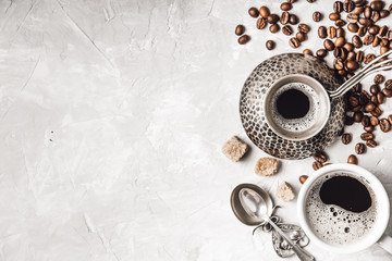 Wall Mural - Coffee with  coffee beans on grey textured background. Top view with copy space. Background with free text space.