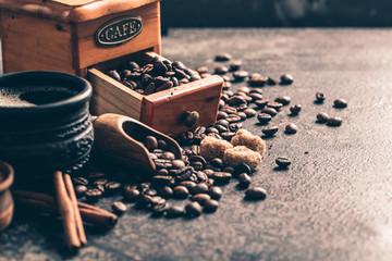 Fototapete - Coffee with coffee grinder and coffee beans on dark textured background.