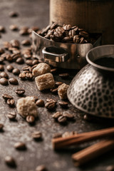 Fototapete - Coffee cup and coffee beans on dark stone background.