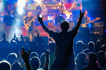 Fans at live rock music concert cheering