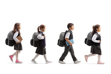 Schoolchildren in uniforms walking in line