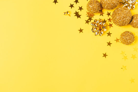Yellow Christmas background with golden balls