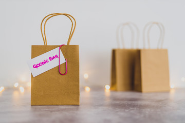 free samples and gifting conceptual still-life, shopping bag with price tag with Goodie Bag text on it and other bags in the background