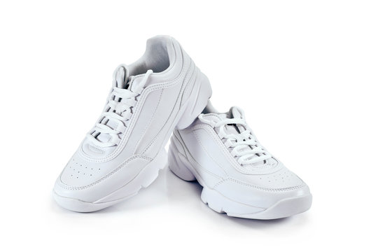White sneakers isolated on a white background.