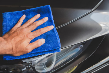 Man asian inspection and cleaning Equipment car wash With gray car For cleaning to quality to customer on car showroom of service transport automobile transportation automotive image.