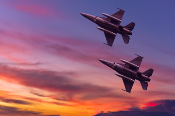 Army Show performant of air craft in air show with twilight sky background.