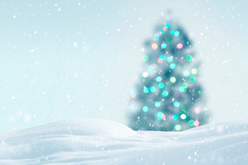 Christmas tree with colorful lights on snowy background