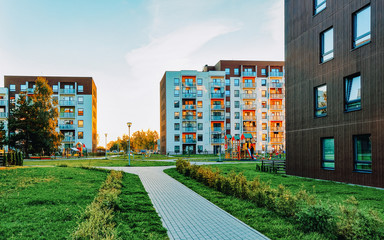 Modern residential apartment and flat building exterior with outdoor facilities. New luxury house...