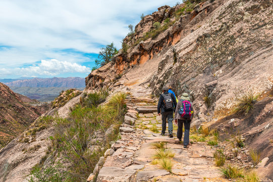 A group of tourist and backpackers walking on the Inca Trail of Bolivia outside of Sucre in Chataquila.