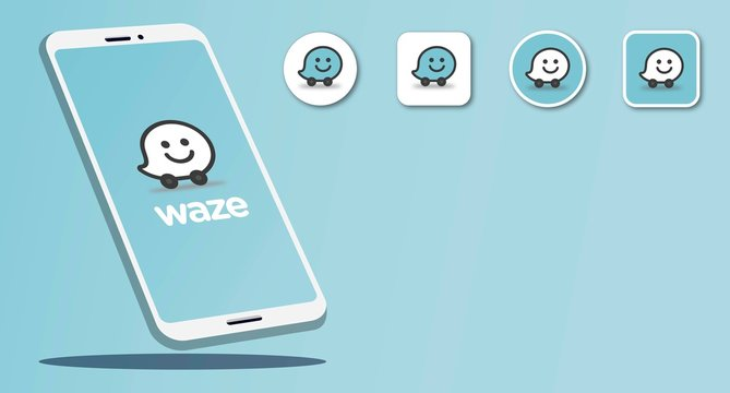 Smart phone with navigation application logos Waze