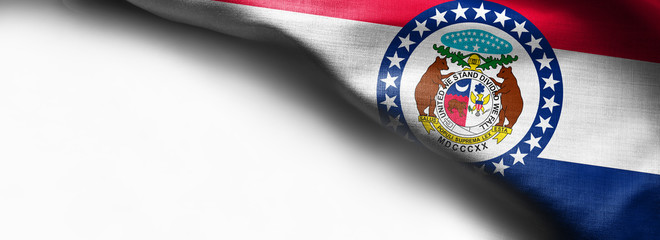 Fabric texture of the Missouri Flag background - flag on white background - right top corner - free copy space