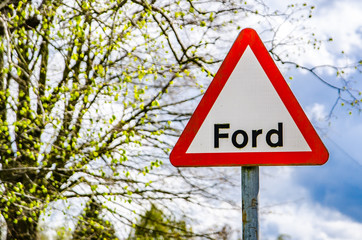 British street sign showing the word Ford against spring background.
