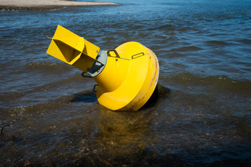 Warning buoy at the river. drought concept