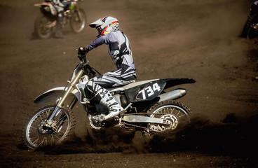 motocross racer track on ground trail. spray of dirt rear wheel