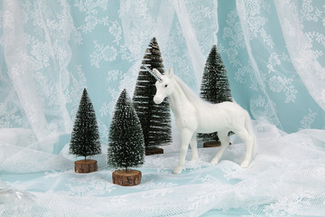 Keuken foto achterwand Fantasie Landschap snow unicorn on a lace background
