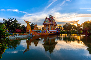 A huge Thai Suphannahong, also called Golden Swan or Phoenix boat at the WatpahSuphannahong Temple twilight time in sisaket, Thailand