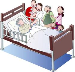 介護ベッドの老人と介護士と家族