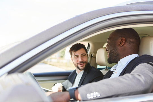 Business people in the car as a carpool