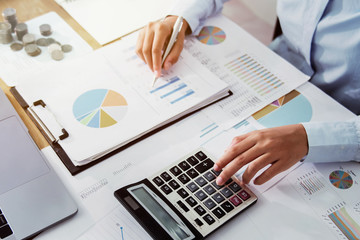 .Business woman working in finance and accounting Analyze financial budget in the office