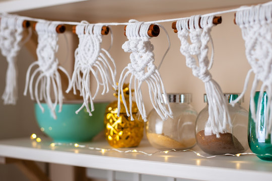 Handmade crafted macrame hanging from kitchen shelf