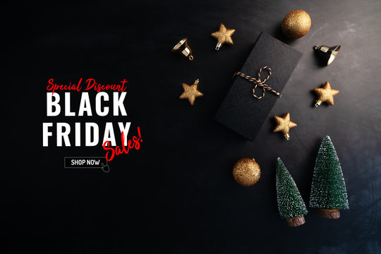 gift box with Christmas decoration for Black Friday Sale concept on black background