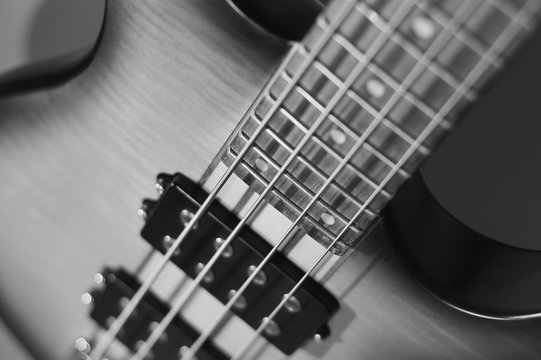 electric bass guitar closeup . white background . black and white