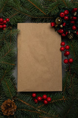 Creative layout made of Christmas tree branches with concrite background and blank gift paper. Nature New Year concept