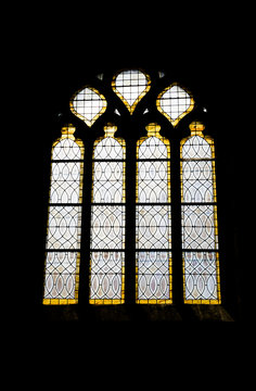detailed view of a stained glass window in the historic church of Saint Ronan in Locronan in Brittany