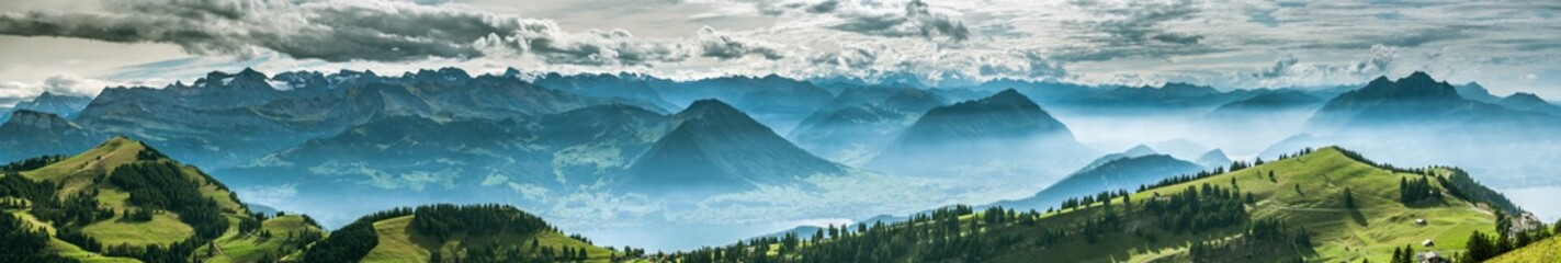 Wall Murals Blue sky Panoramic view on beautiful Swiss Alps surrounding Lake Lucerne