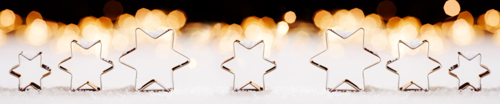 Christmas themed banner/ header with star shaped cookie cutters and twinkling lights