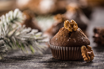 Christmas chocolate delicious muffins sprinklad with sugar powder and wallnut on top