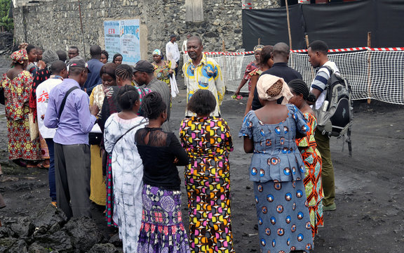 Congolese residents gather around Medecins Sans Frontieres (MSF) health workers as they prepare the introduction of the second ebola vaccine in Majengo neighborhood of Goma